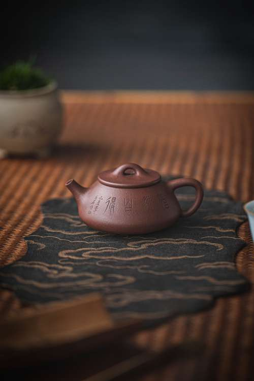 Chinese Teapot On A Bamboo Surface Photo