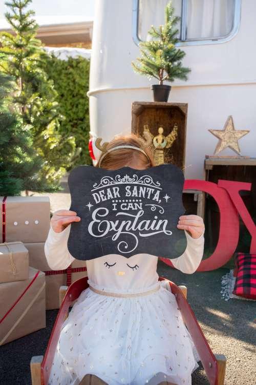 Little Girl Taking Christmas Photos Photo