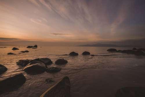A Sweeping Sunset Illuminating A Beach Photo