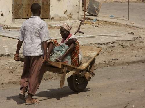 handicap, disabled, sick, infirm, infirmity, transport, handmade wheelchair, assistance, beggar, road