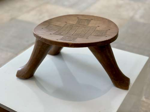 piece of art, artwork, wood, stool, seat, craft, museum, exhibition