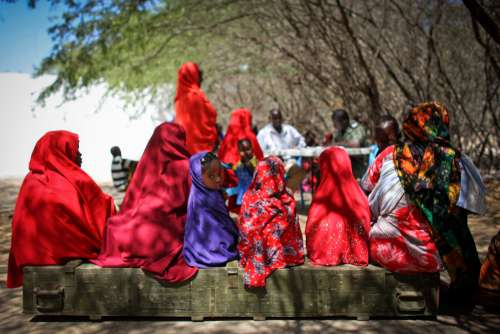 people, women, children, medical service, military service, village checkpoints, hijab, veil, waiting bench