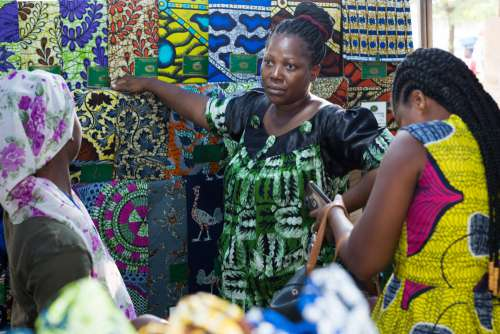 loincloth, fabrics, sale, traditional, tchigan, wax, trade, exhibition, seller, merchant, buyers, market, patterns, magnificent, chic, fashion, African prints, women, facial expression, customers, saleswomen, shop
