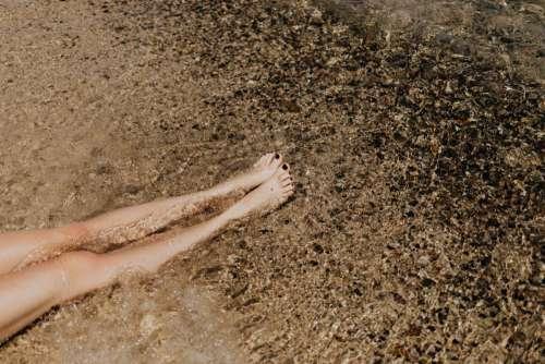 A beautiful blonde sunbathing on a beach in Sardinia