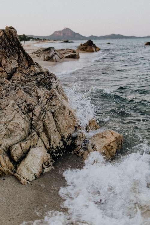 Waves crashing over rocks on the beach