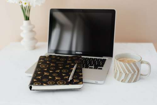 Home Office - Laptop - organizer & cup of coffee
