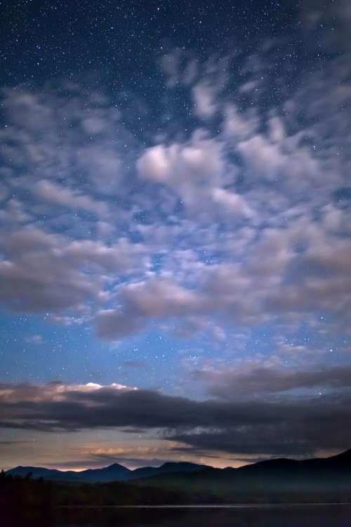 night sky clouds stars mountians