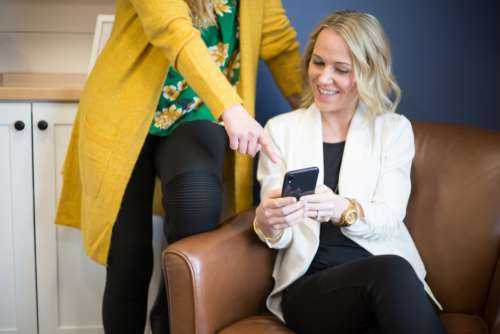woman phone technology online pointing