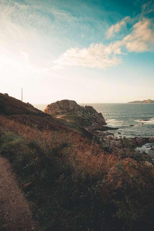 Sunlight Illuminating Rocky Shore Photo