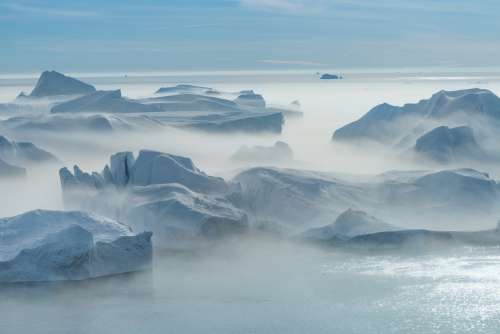 Fog Rolls Over Icey Glaciers Photo