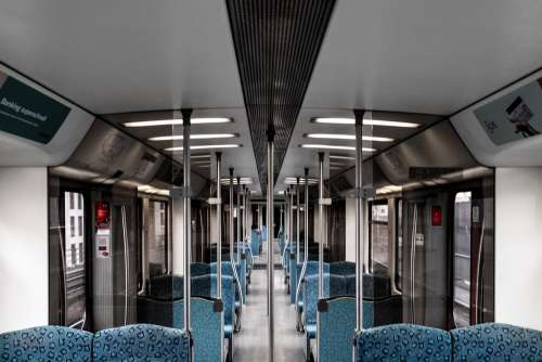 An Empty Sunway With Blue Seats Photo