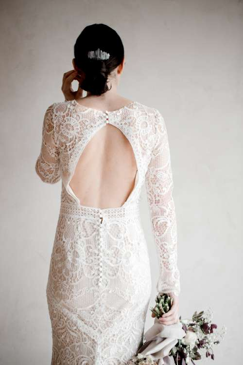 Bride In Lace Wedding Dress Holding Bouquet Photo
