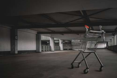 Abandoned Shopping Cart In Parking Lot Photo