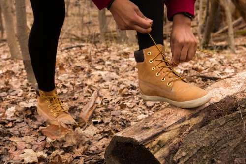 Hiker Ties Their Shoe Photo