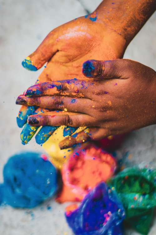 Two Hands Rubbing Powdered Paint Photo
