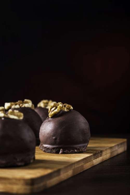 Chocolate truffles with walnuts close up