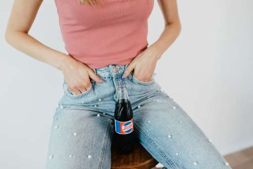 Young woman with Pepsi Cola bottle