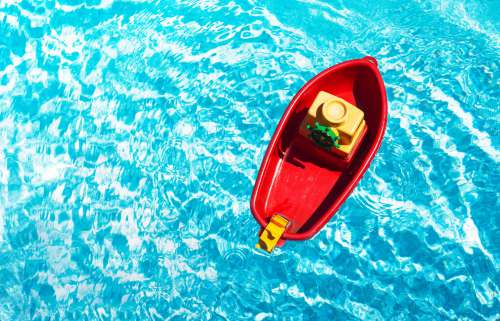 Red Toy Boat In A Swimming Pool Photo