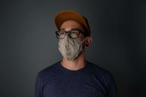 Man With Glasses And Face Mask Photo