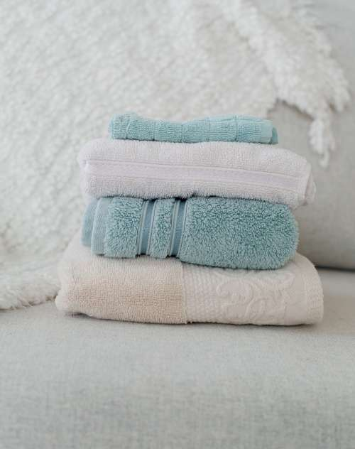 Folded Towels Placed On Couch Photo