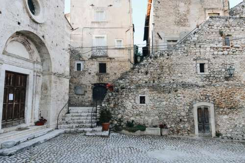 Stone Courtyard Sorrounded By Buildings Photo