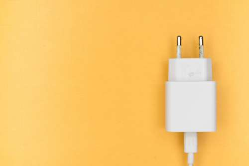 White Phone Charger On Yellow Photo