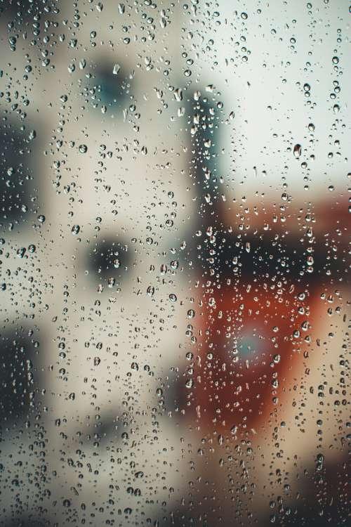 Rain Drops Illuminated By Colors On Window Photo