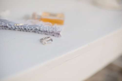 A Set Of Wedding Rings Set On White Table Photo