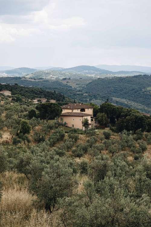 House Nestled Within The Mountains Photo