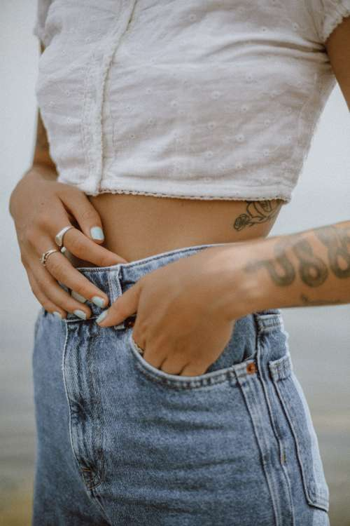 A Fashionable Person With Tattoos Poses Photo