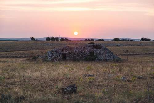 Sunset Over Small Pile Of Rubble Photo