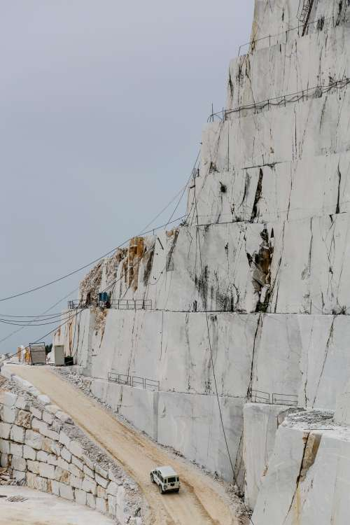 The Edge Of A Quarry With White Rocks Photo