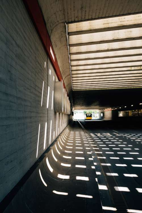 Dotted Lines In A Tunnel With Light Photo