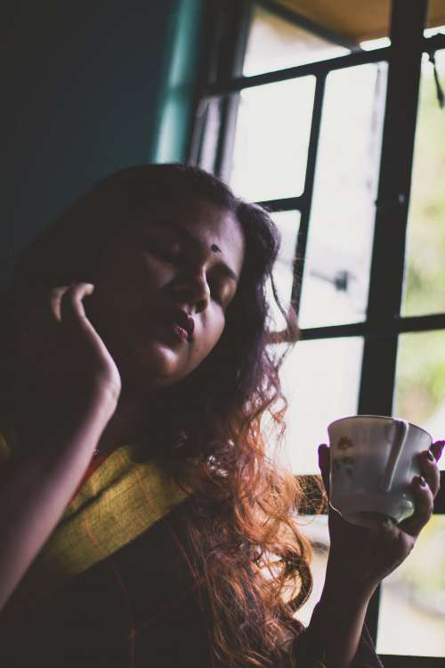 Woman At A Window Drinking Her Tea Photo
