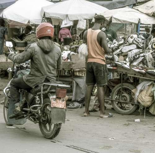people, transportation system, man, driver, street, market, commerce, bike, business, shoes, hustlers, street vendors