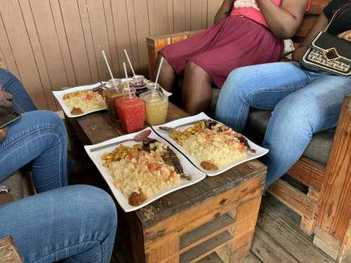 people, man, family, woman, food, restaurant, drinks, juice, taste, flavor, fish, attiékè, plantain, fried banana, aloko, pepper, bissap, tchakpalo, meal, dish, lunch, nutrition,