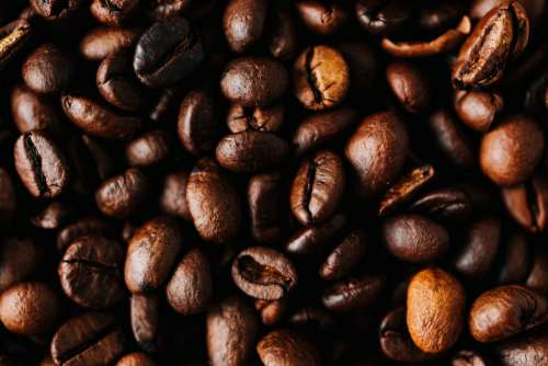 Dark roast coffee beans background