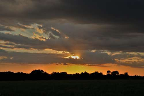 Sunset Over Country Field