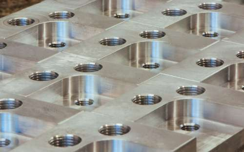 Precision Engineered Metal With Screw Holes
