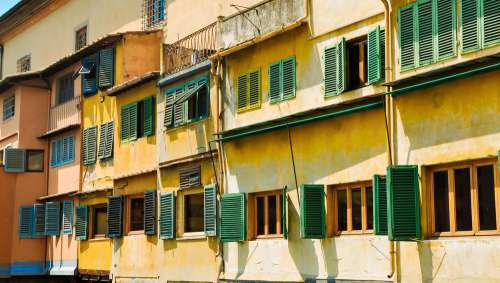 Open Shutters On Colorful Building