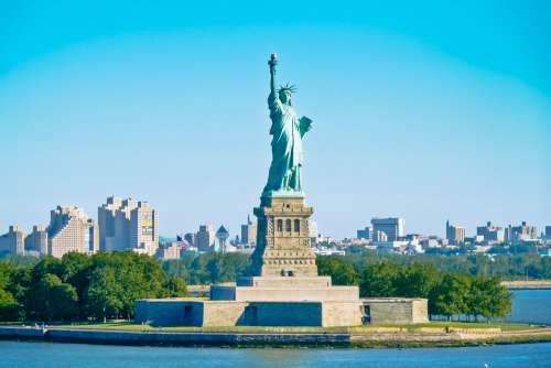 Statue Of Liberty Skyline And Blue Sky