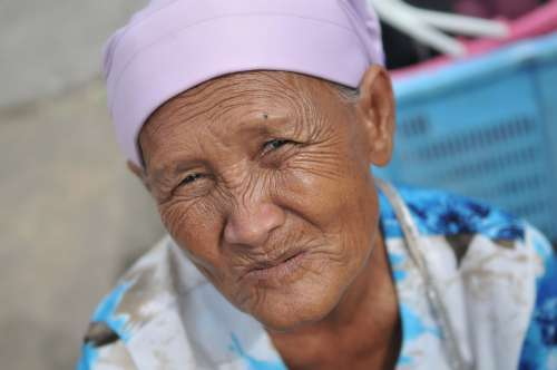 Old Lady With Wrinkles Looking At Camera