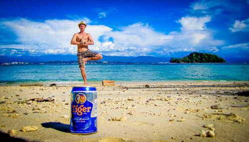 Man Using Perspective To Stand On Top Of Beer Can