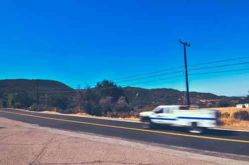 Van With Motion Blur On Open Road In USA