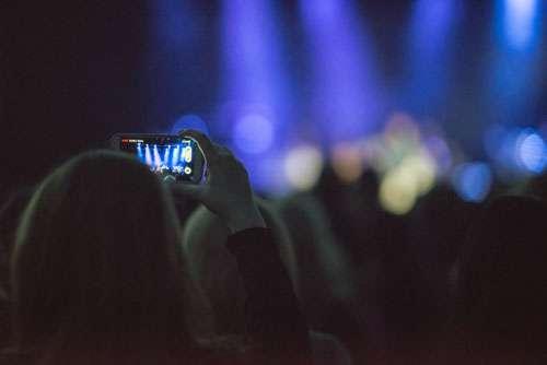 Girl Filming Live Concert On Smartphone