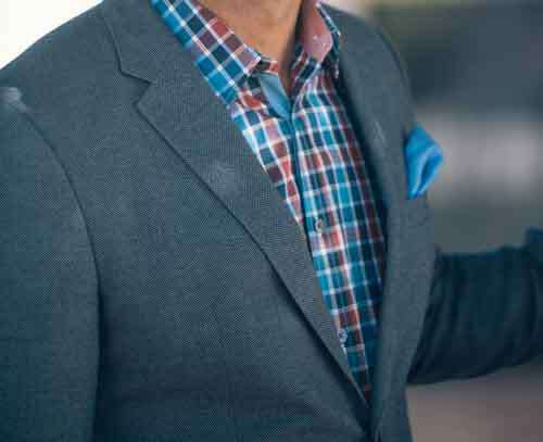 Detail Of Male Fashion Jacket And Colored Plaid Shirt