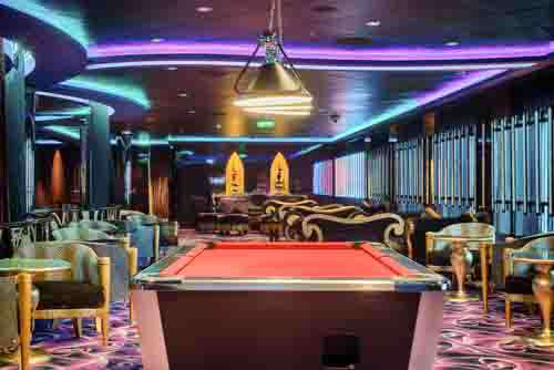 Red Pool Table With Contempoary Furniture And Lights