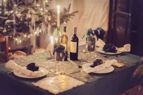 Festive Table Layed For Christmas Dinner With Wine