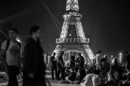 Eiffel Tower At Night With Groups Of People