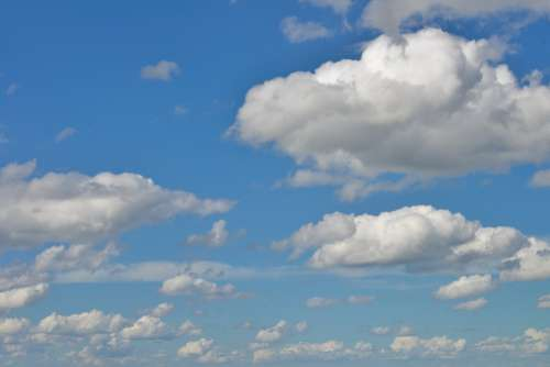 Lots Of Fluffy Clouds In A Light Blue Sky
